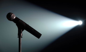 Spot lit microphone and stand on an empty stage